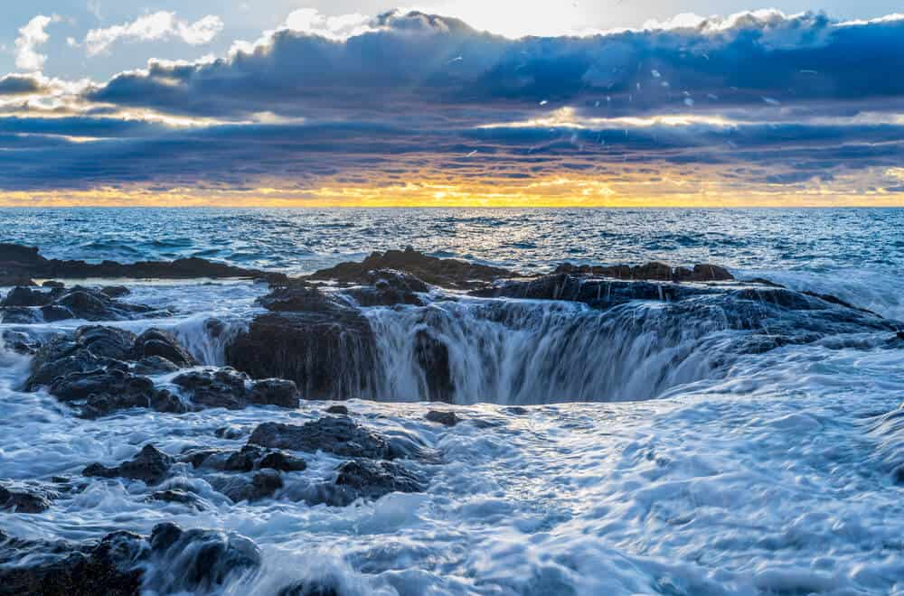 Dramatic sunset at Thor's Well in Cape Perpetua Scenic Area