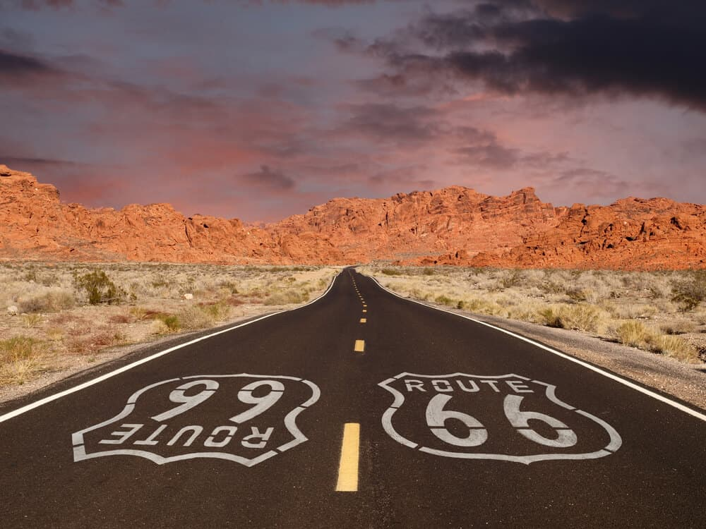 Route 66 sign amidst Red Rock mountains in Arizona