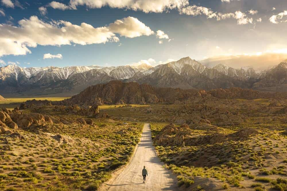 A lonely person walking on a pathway in Alabama hills in California